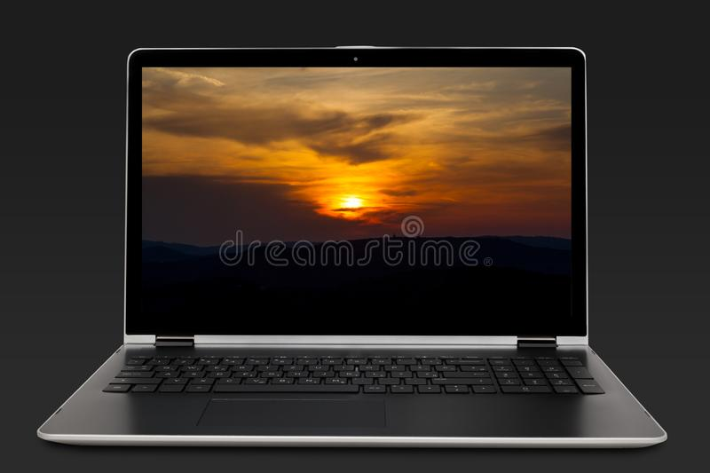 Modern business laptop with sunset. On a screen over dark backgrond royalty free stock images