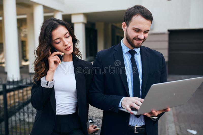 Modern business people are working together , woman making a phone call stock image