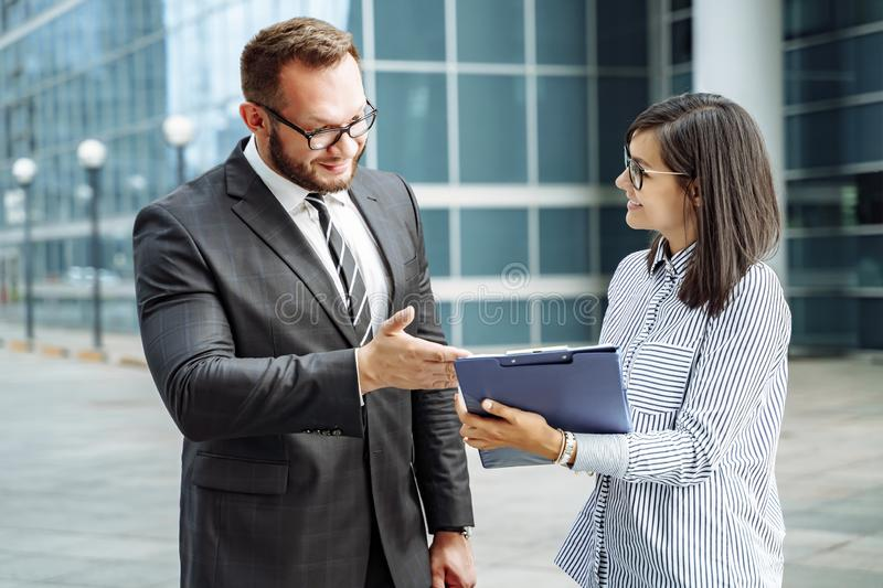 Modern business. Business team brainstorming. Successful business man and young woman communicating stock photos