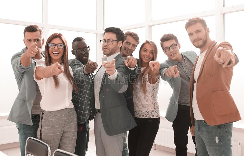 Modern business team pointing at you stock image