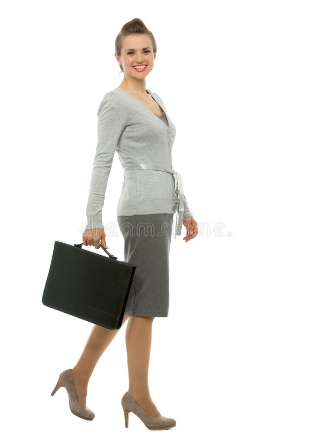 Modern business woman with briefcase walking stock images