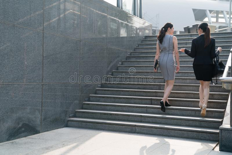 Modern business woman climbing stairs. royalty free stock photo