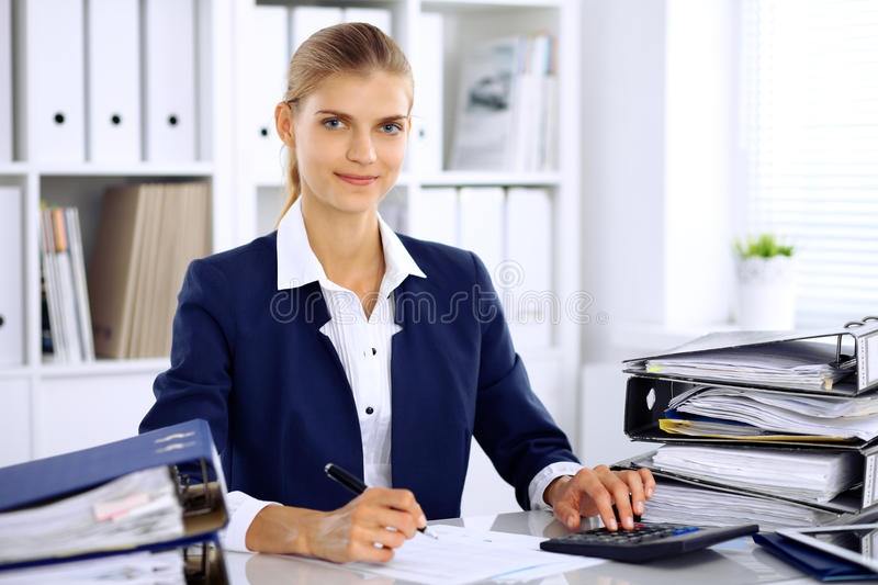 Modern business woman or confident female accountant in office stock images