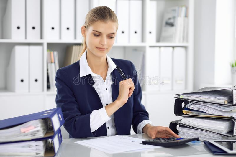 Modern business woman or confident female accountant in office. Student girl during exam preparing. Audit, tax service stock images