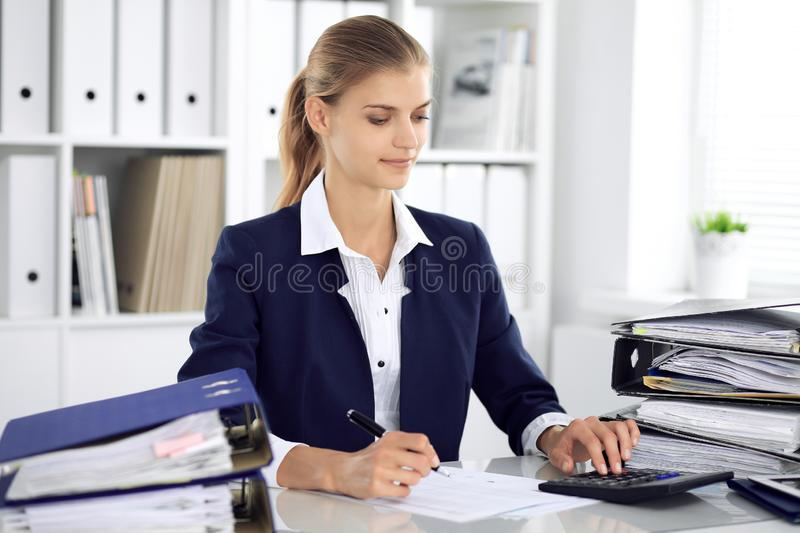 Modern business woman or confident female accountant in office. Student girl during exam preparing. Audit, tax service stock image