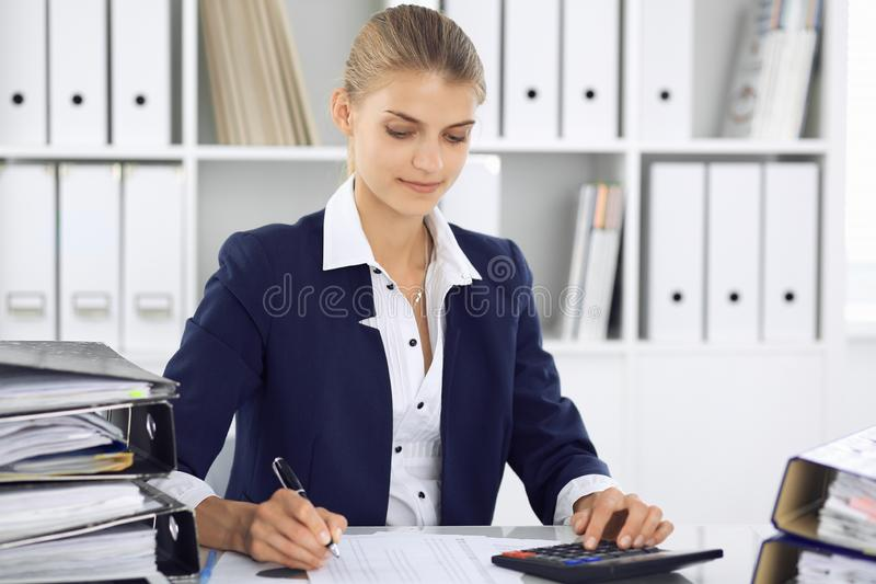Modern business woman or confident female accountant in office. Student girl during exam preparing. Audit, tax service royalty free stock photos