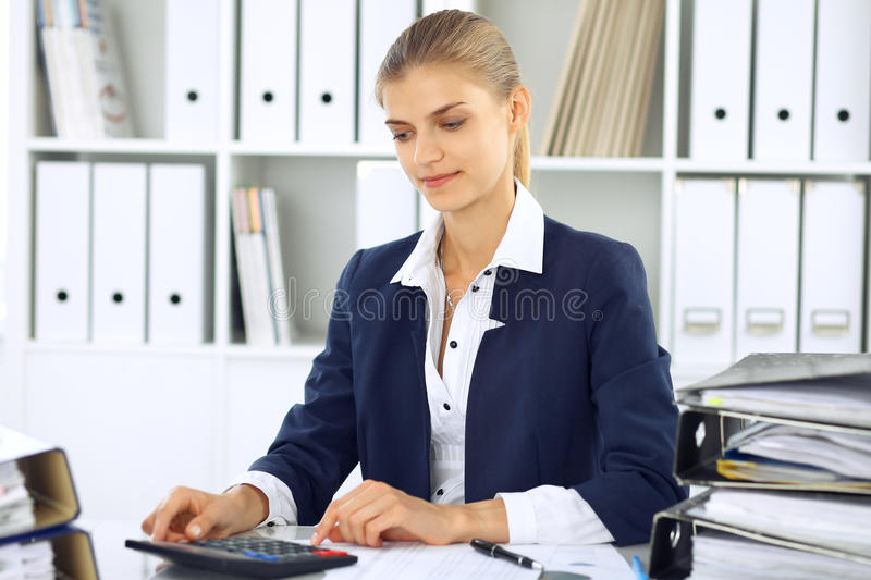 Modern business woman or confident female accountant in office. Student girl during exam preparing. Audit, tax service. Or education concept royalty free stock photos