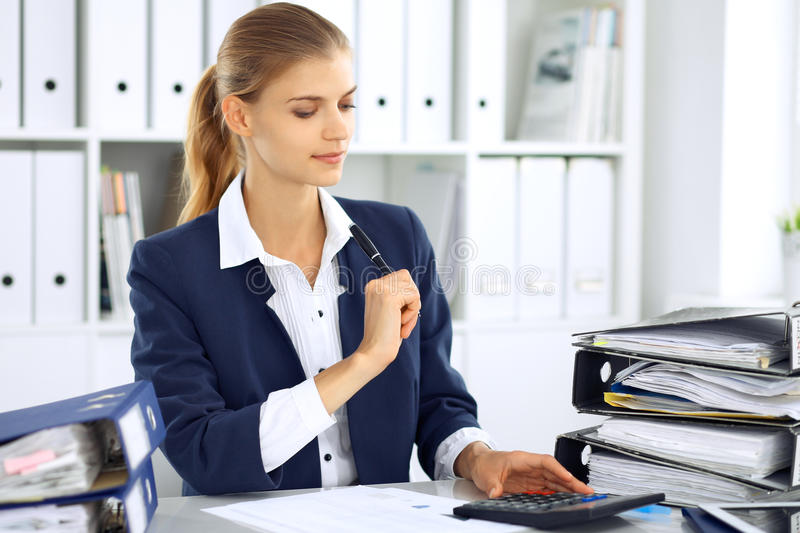 Modern business woman or confident female accountant in office. Student girl during exam preparing. Audit, tax service. Or education concept royalty free stock images