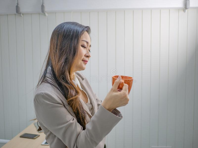 Modern business women hold her coffee cup or mug stock photos