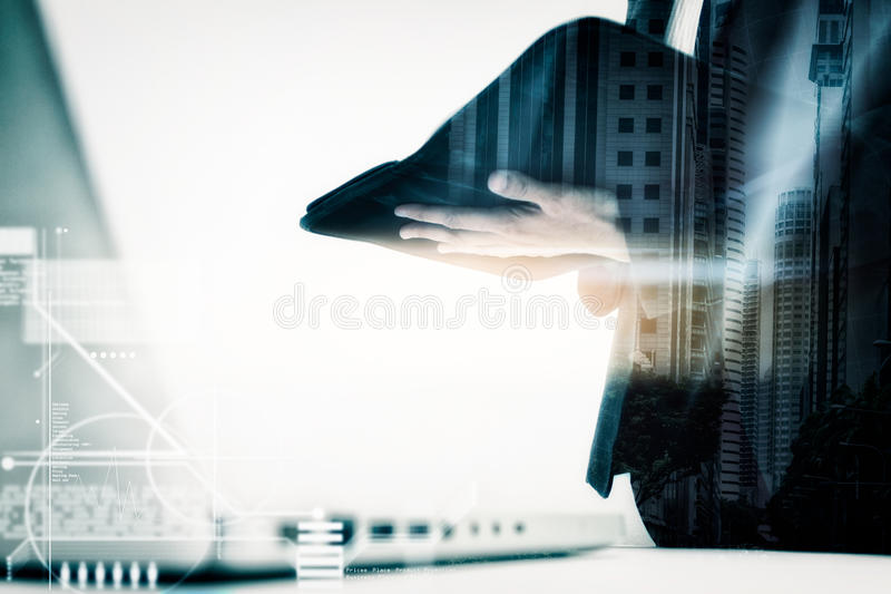 Modern business woman in the office with copy space,Business woman standing looking for outside the window after prepare document. S and graph business diagram royalty free stock photo