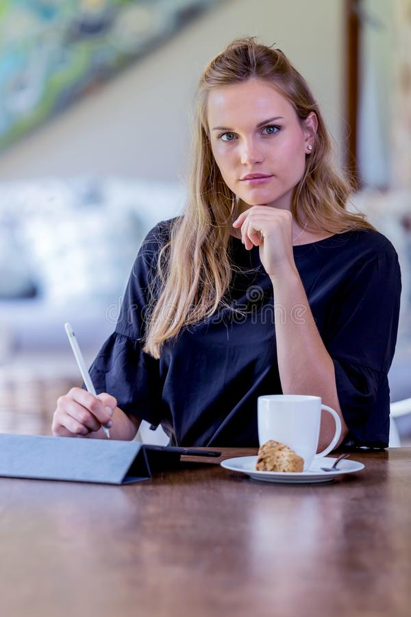 Modern business women working on tablet device. royalty free stock images