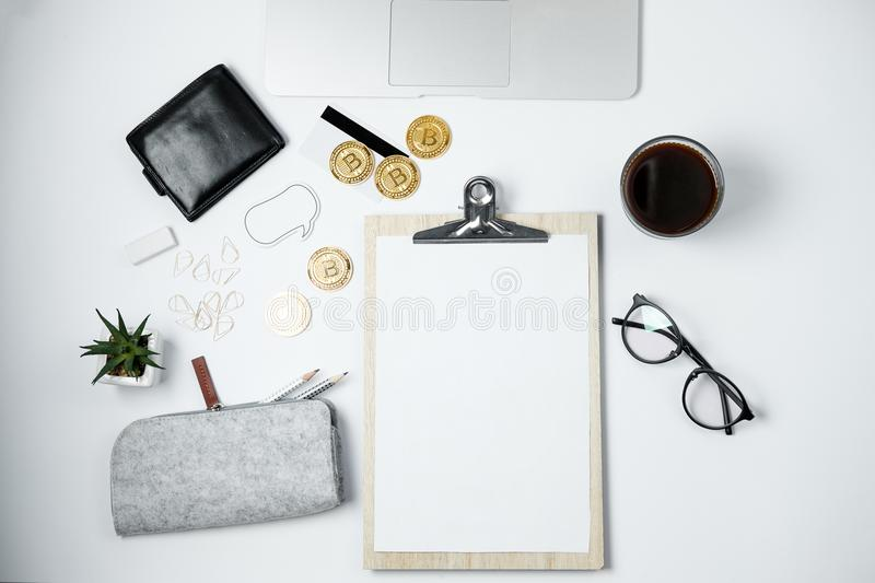 Modern business work space with Bitcoin, laptop, coffee, station royalty free stock photography