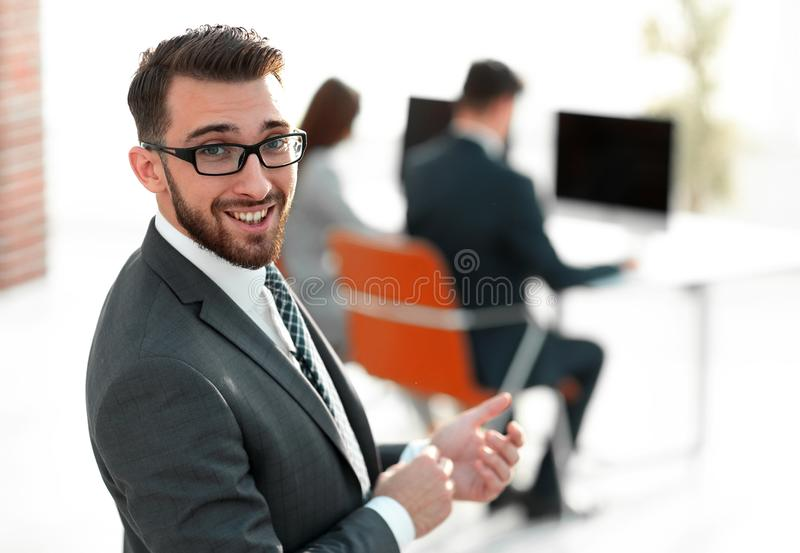 Modern businessman on blurred background office. Photo with copy space stock photography