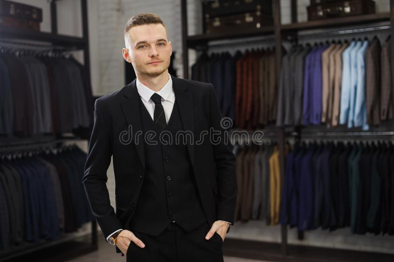 Modern businessman. Fashion shot of a handsome young man in elegant classic suit. Perfect to the last detail. Men`s royalty free stock photo