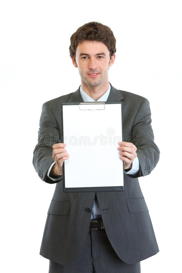 Modern businessman showing blank clipboard royalty free stock image