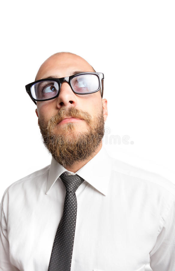 Modern Businessman thinking. Modern businessman with beard and glasses looking up and thinking. Isolated on white with big copy space royalty free stock images