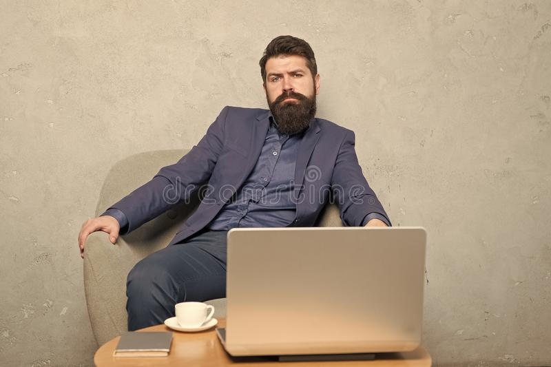 Modern businessman. Businessman work laptop. Man drink coffee in business office. Responding business email. Digital royalty free stock images
