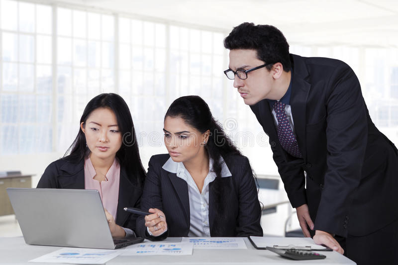 Modern businesspeople having meeting in office royalty free stock images