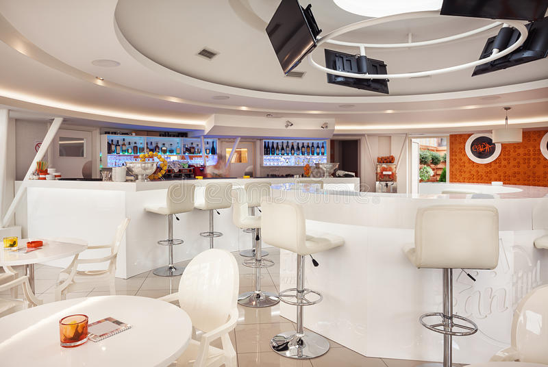 Modern Cafe Interior. Interior of a modern cafe bar, white futuristic furniture with interesting lighting royalty free stock images