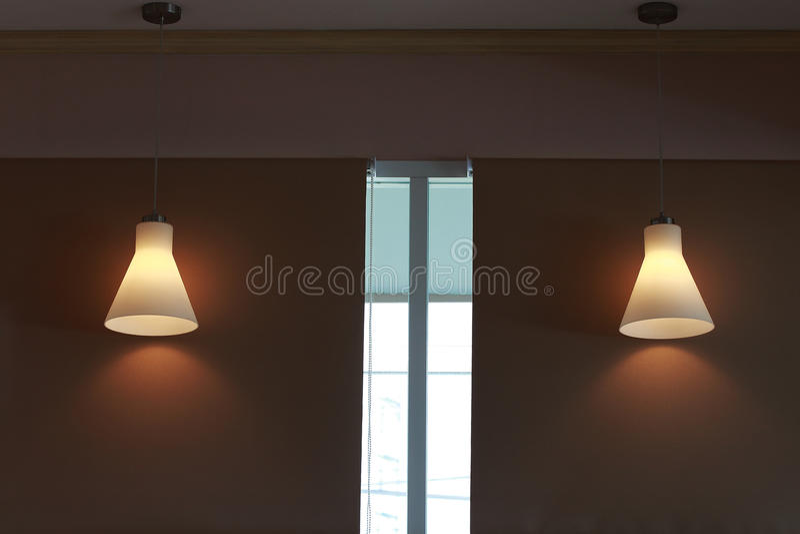 Modern candelabrum. Open on dark wall background stock photography