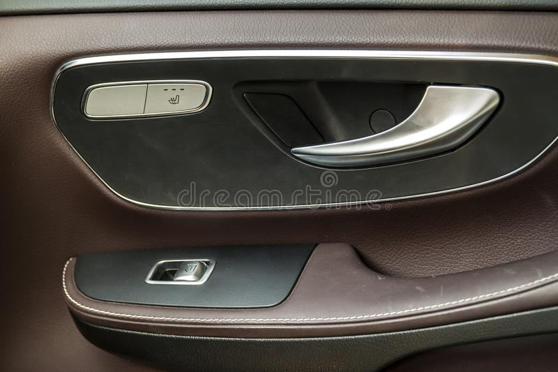 Modern car door handle and window control switch stock photos