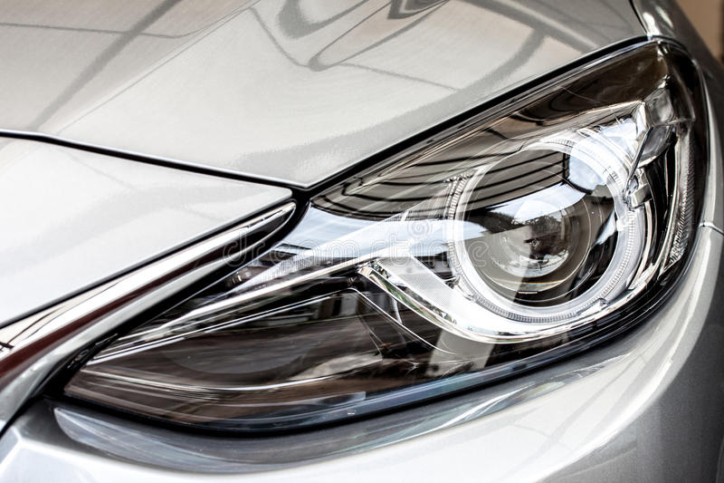 Modern car head lamp. Modern sport car's head lamp, xenon projector stock photos