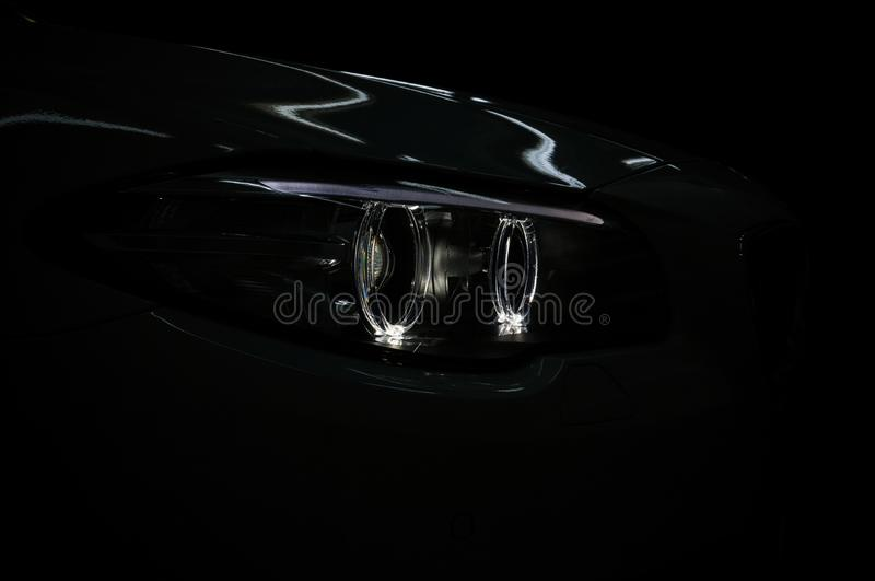 Lights reflections on the dark modern car. stock photography
