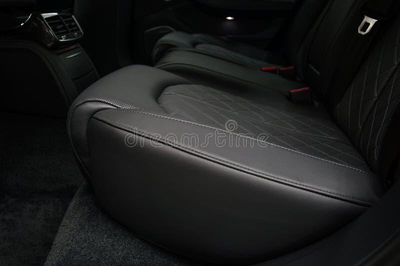 Modern car interior detail. Back passenger seats stock photos