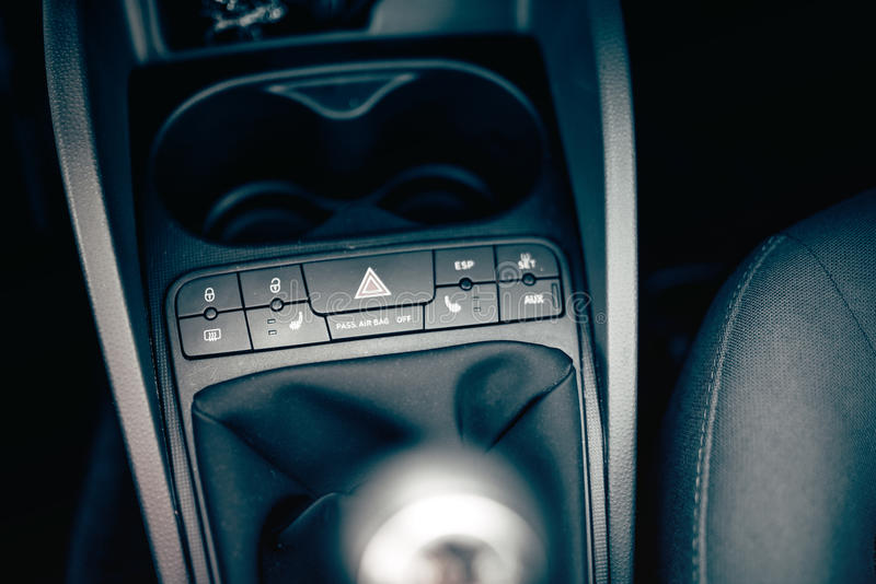 Modern car interior details, modern buttons dashboard and panel. Chair heating, airbags options royalty free stock photo