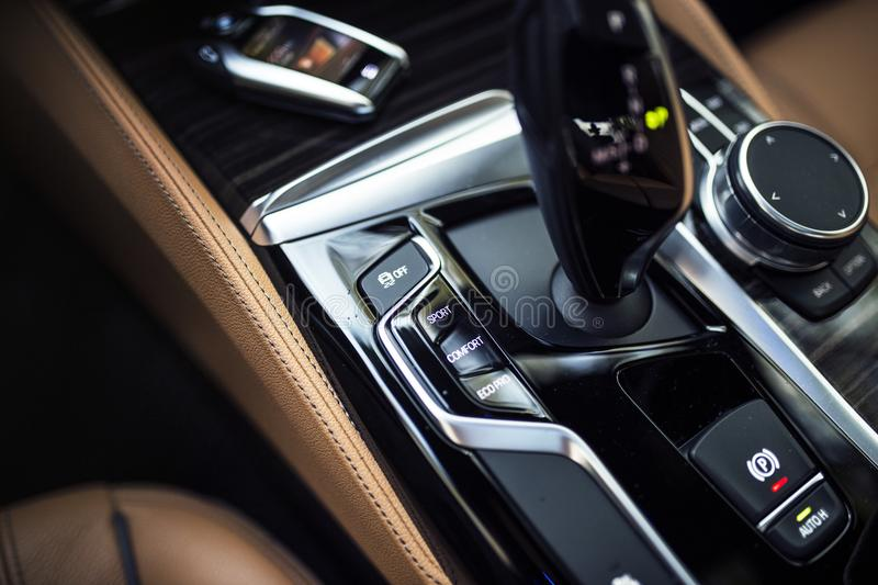 Car Interior: Details of Modern Center Console with Dials, Buttons and Gear knob royalty free stock photography