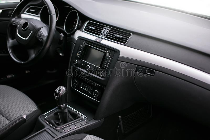 Modern car interior. Steering wheel, dashboard, speedometer, display. Modern luxury car interior - steering wheel, shift lever and dashboard. Steering wheel royalty free stock image