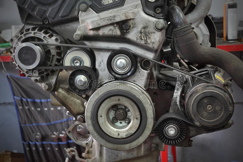 Modern car servicing pulley, belt and generator royalty free stock image