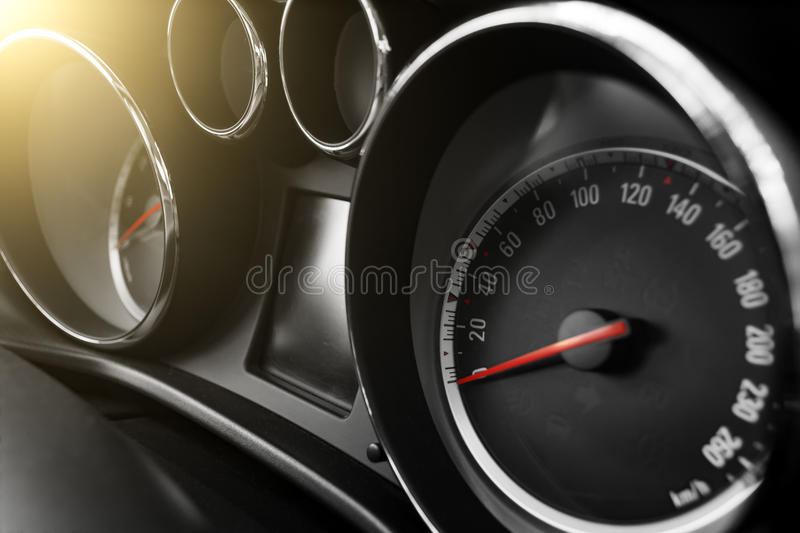 Modern car speedometer and odometer at daytime. New modern car speedometer and odometer at daytime royalty free stock image