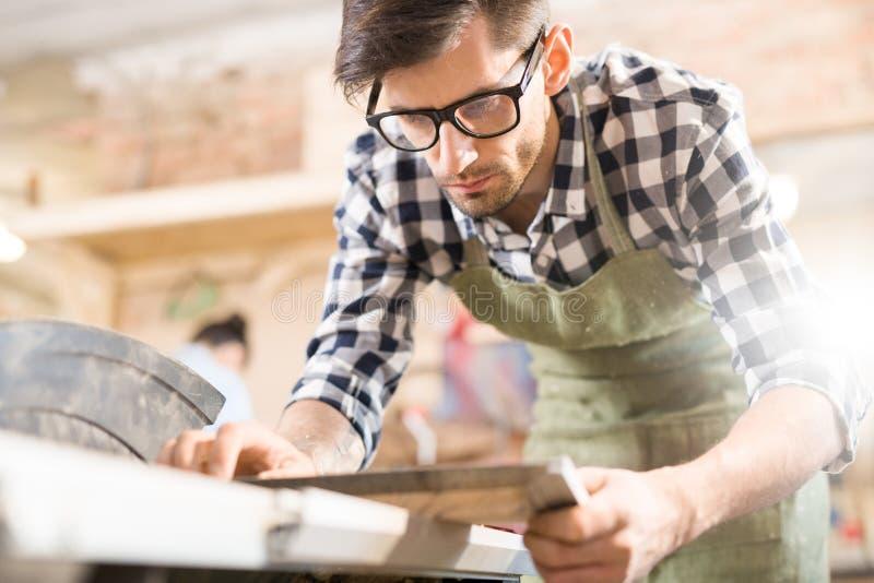 Modern Carpenter Measuring wood stock images