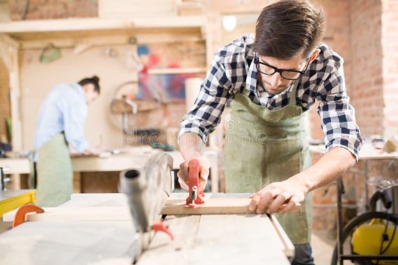 Modern Carpenter at Workstation stock images