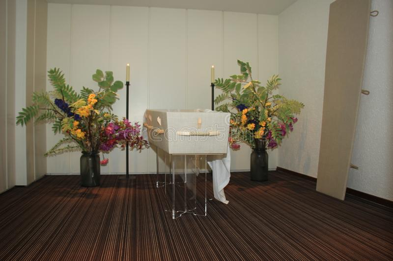 Modern casket in a funeral home stock photo