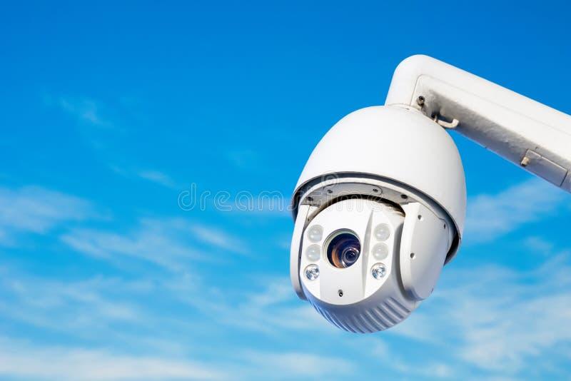 Modern CCTV camera on a clear blue sky background. Close-up of modern CCTV camera on a clear blue sky background stock photos