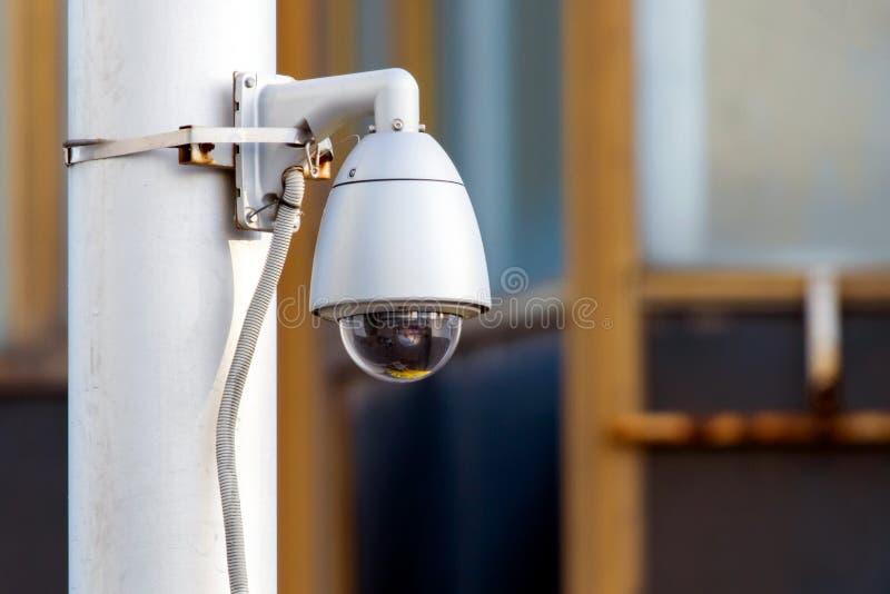 Modern CCTV camera. Concept of surveillance and monitoring. Modern CCTV camera on sky background. Concept of surveillance and monitoring, safety, electronic stock photos