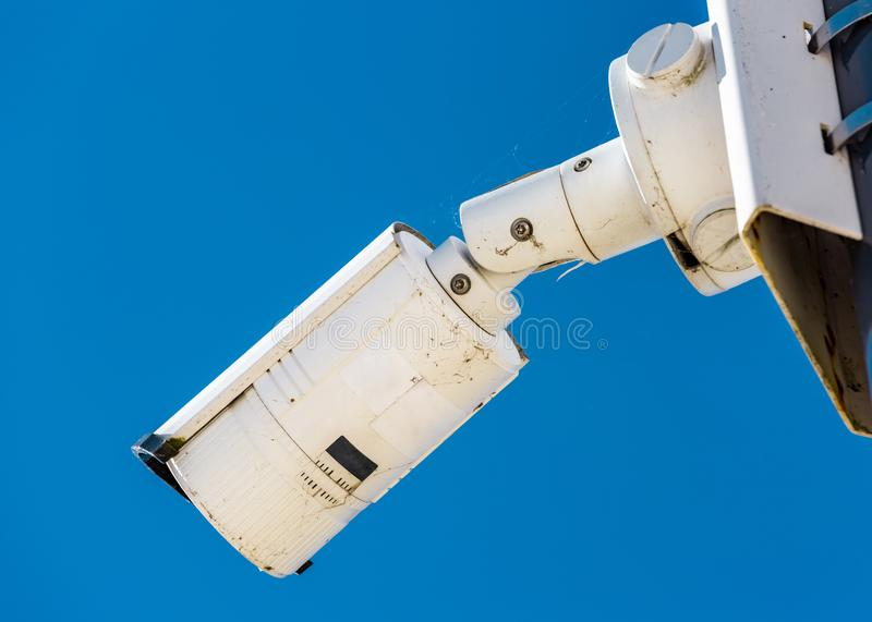 Modern CCTV camera on the wall of an industrial building. Close-up of modern CCTV camera on the wall of an industrial building stock image