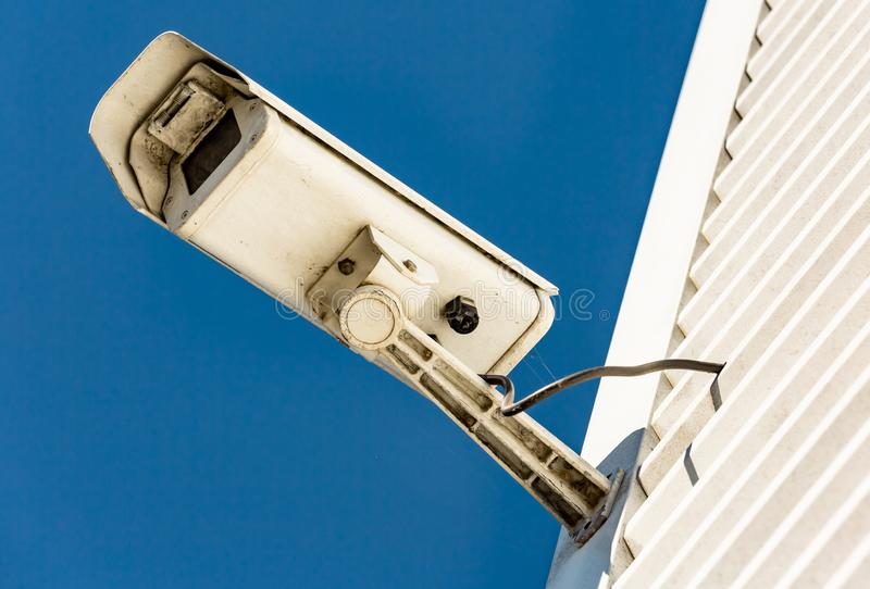Modern CCTV camera on the wall of an industrial building. Close-up of modern CCTV camera on the wall of an industrial building royalty free stock photography