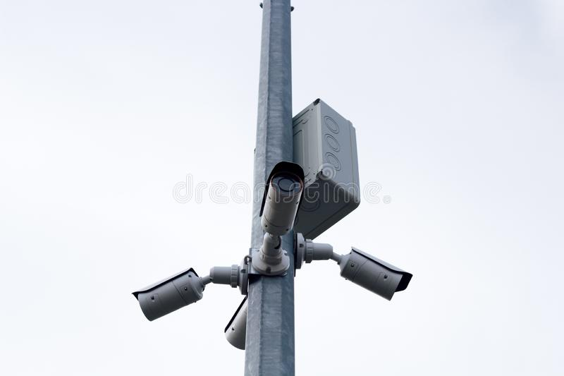 Modern CCTV cameras. Against gray sky royalty free stock photography
