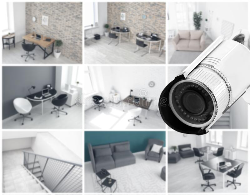 Modern CCTV-kamera med suddig sikt av kontorslägen royaltyfri fotografi