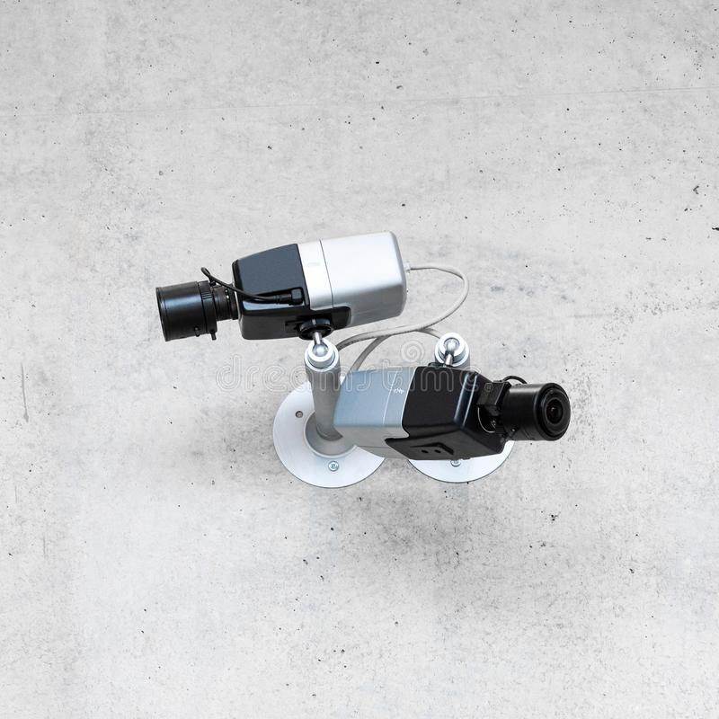 Modern cctv security cameras on concrete wall stock images