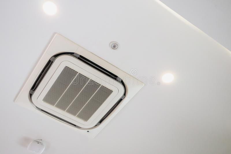 Ceiling mounted cassette type air conditioning system. Modern ceiling mounted cassette type air conditioning system stock image