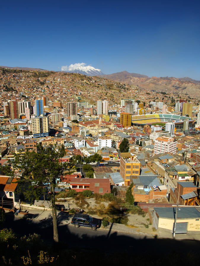 Modern centre of La Paz and Illimani Mountain stock image