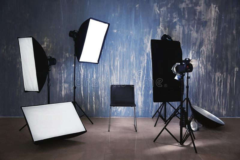 Modern chair in photo studio with professional equipment royalty free stock image