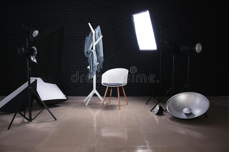 Modern chair in photo studio with professional equipment stock photography