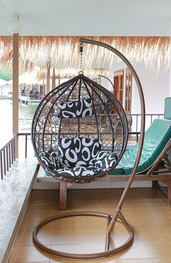 Modern chair swing on balcony at resort.  stock image