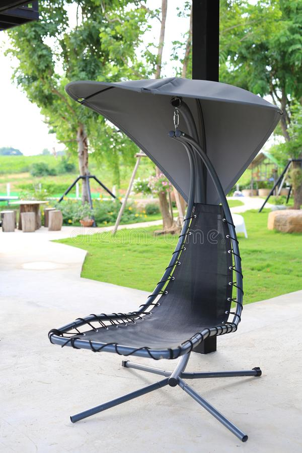 Modern chair swing in the garden at resort.  stock image