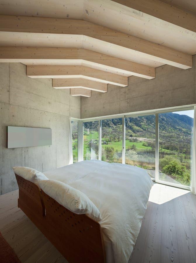Modern chalet, bedroom stock photos